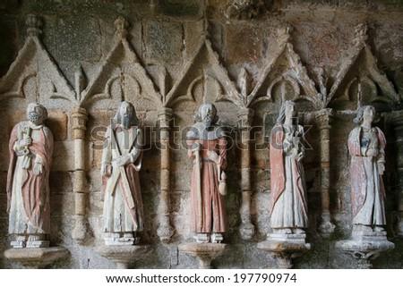 Ancient statues in XIII century La chapelle de Kermaria an Iskuit - stock photo
