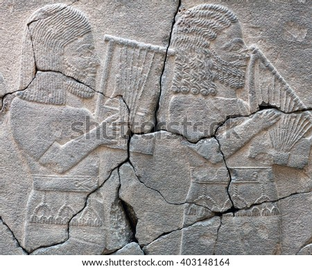 Ancient stone bas-relief with musicians of late Hittite period (Aramaean, 8th Cent. B.C.) in Istanbul Archaeological Museum, Turkey - stock photo