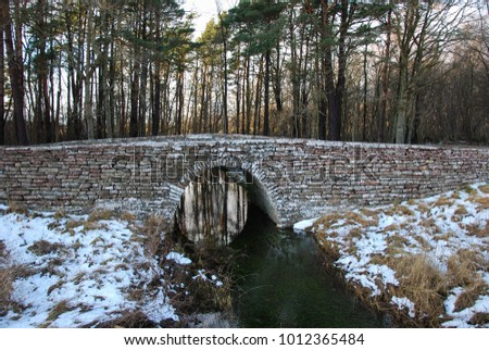 Ancient stone bridge by a small creek on the swedish island Oland