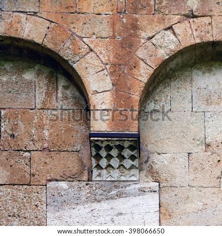 Ancient stone church wall - stock photo