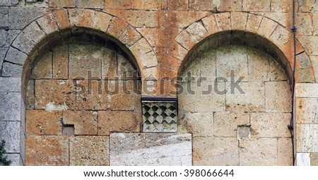 Ancient stone church wall in Abbey Sant'Antimo, Italy