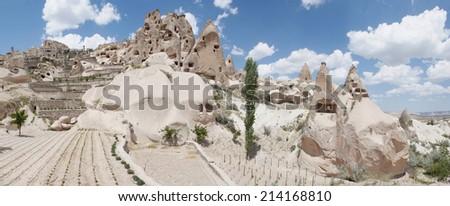 ancient stone dwellings in Cappadocia - stock photo