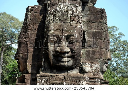 Ancient stone faces on tower of Bayon temple, Angkor Thom, Seimreap, Cambodia