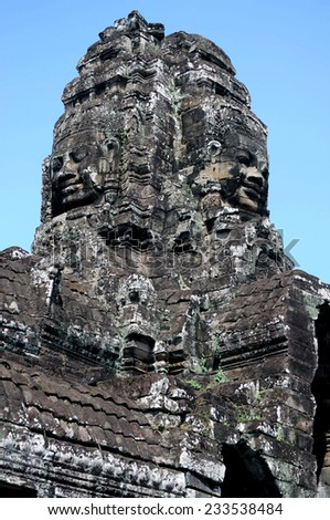 Ancient stone faces on tower of Bayon temple, Siemreap, Cambodia - stock photo