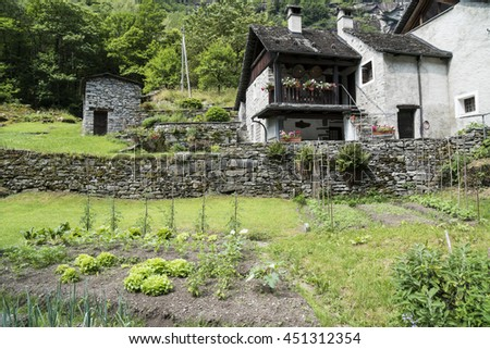 Ancient stone house with vegetable garden