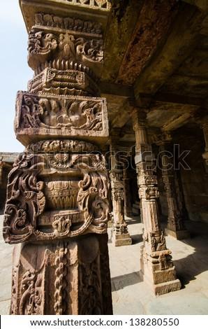 ancient stone pole in qutub minar, india - stock photo
