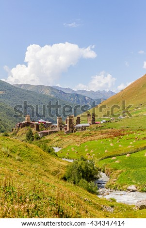 ancient stone tower in Georgia, mountain background - stock photo