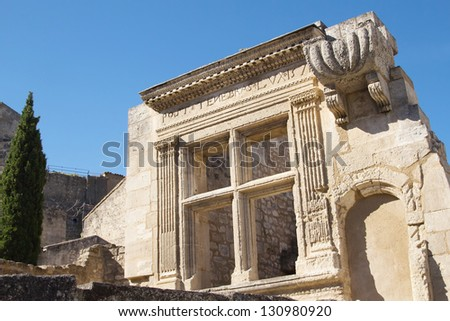 Ancient stone window in French village Les Baux de Provence (France) - stock photo