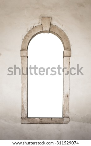 Ancient stone window suitable as a frame or border. - stock photo