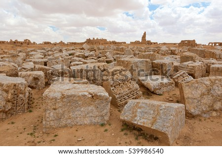 Ancient stones lying on the desert ground in Syria