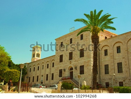 Ancient street in Nazareth, Israel. Date palm trees - stock photo