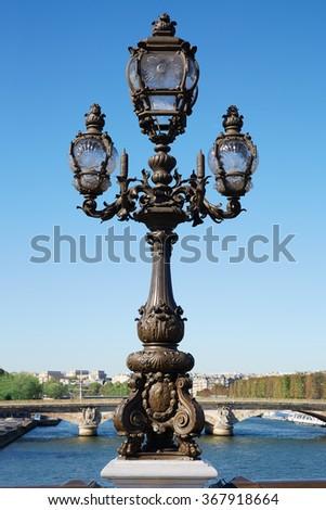 Ancient street lamp in Paris, Alexander III bridge - stock photo