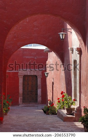Ancient street with red houses at Arequipa, Peru