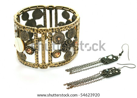 Ancient style bracelet and earrings isolated on white background.