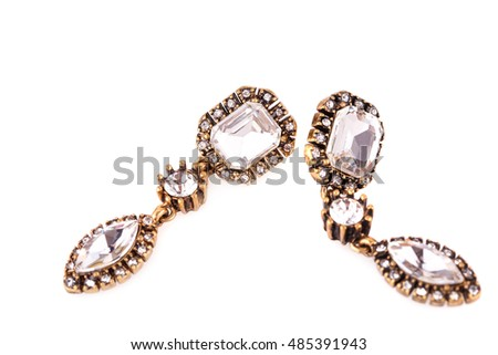 Ancient style earrings isolated on white background.