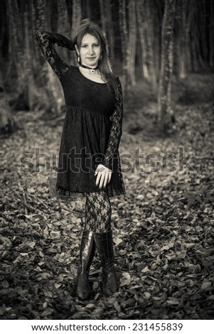 Ancient Style Portrait Of Mysterious Girl With Gothic Dress And Forest Background
