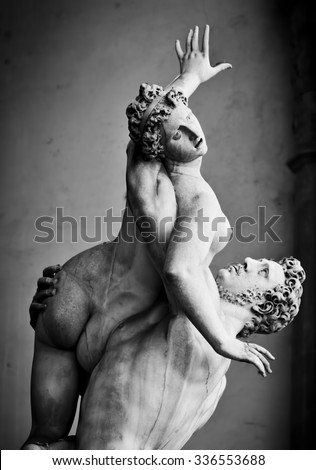 Ancient style sculpture of The Rape of the Sabine Women in Loggia dei Lanzi in Florence, Italy. Black and white - stock photo