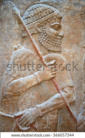 Ancient sumerian stone carving with cuneiform scripting - stock photo