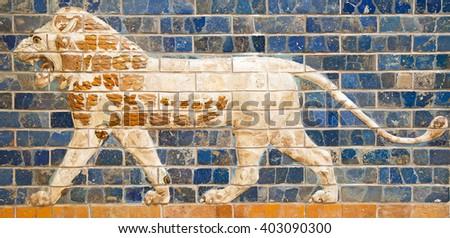 Ancient sumerian tle panel depicting lion - stock photo