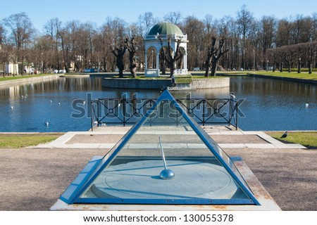 Ancient sundial at a pond in park Kadriorg, Tallinn