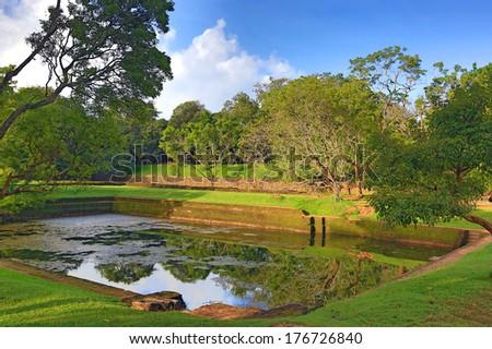Ancient swimming pool in jungle. Sigiriya, Sri Lanka - stock photo