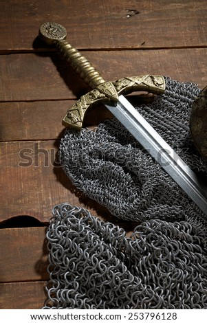 Ancient sword with the bronze handholdon a beautiful background - stock photo