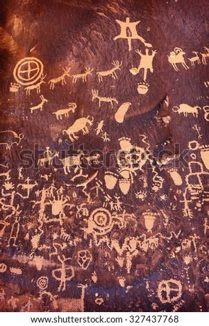Ancient symbols texture, Petroglyphs on Newspaper Rock, Utah, USA. - stock photo