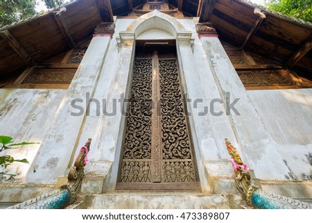 Ancient teak carve on the temple door at Wat Don Sak, Uttaradit, Thailand