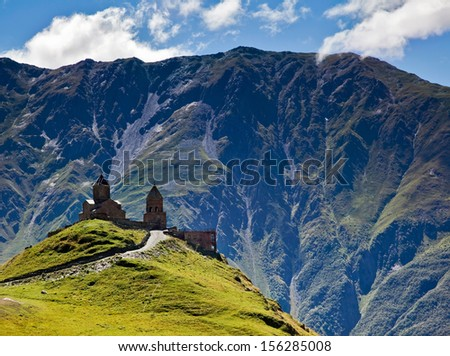 ancient temple Gergeti in the mountains of Georgia - stock photo