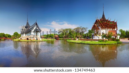 Ancient temple in Thailand in sunny day. Panoramic picture