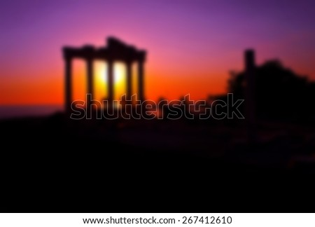 ancient temple of apolon greek ruins in sunset, blurred for presentation effect , abstract background - stock photo