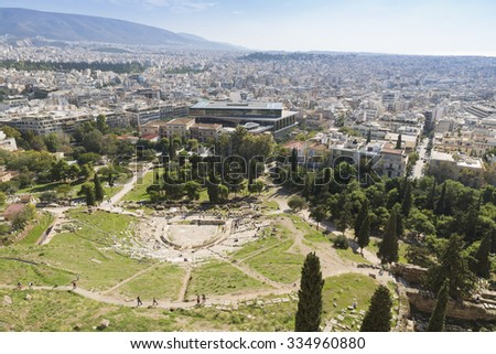 Ancient theater of Dionysus seen from the hill of Athens Acropolis, Greece - stock photo