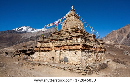 Ancient Tibetan Buddhist stupa in the Nar-Phu Vallley in the Annapurna region, Nepal - stock photo