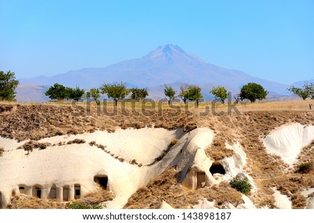 Ancient tomb on the background of an active volcano