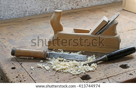 ancient tools:planer and two chisels on the old wooden workbench - stock photo