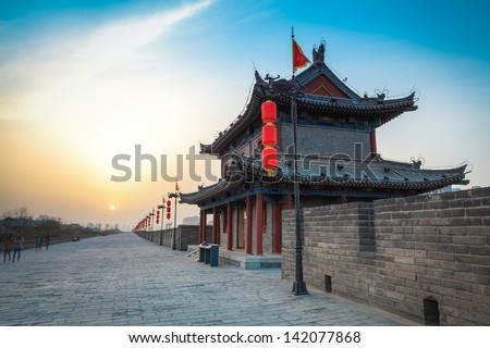 ancient tower on city wall at dusk in Xi'an,China - stock photo