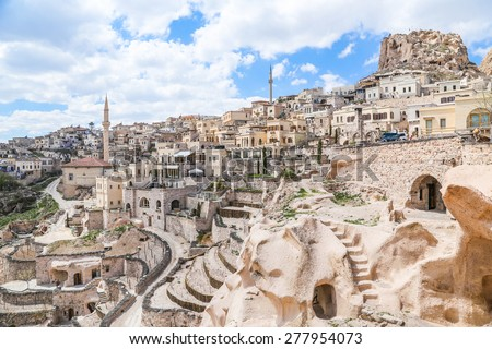 Ancient town and a castle of Uchisar dug from a mountains after sunrise, Cappadocia, Turkey