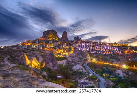 Ancient town and a castle of Uchisar dug from a mountains after twilight, Cappadocia, Turkey - stock photo
