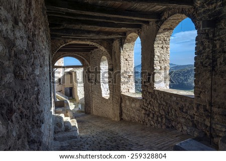 ancient town in Italy, vision suggestive of houses, portico
