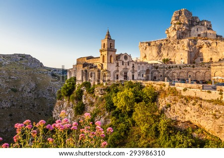 Ancient town of Matera (Sassi di Matera), European Capital of Culture 2019, in beautiful golden morning light at sunrise, Basilicata, southern Italy - stock photo