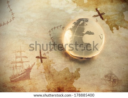 ancient treasure map with glass globe - stock photo