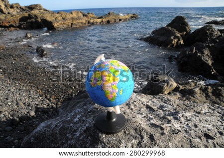 Ancient Vintage Globes Planet Earth near the Atlantic Ocean - stock photo