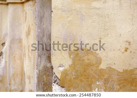 ancient wall detail. Cracked plaster background closeup - stock photo