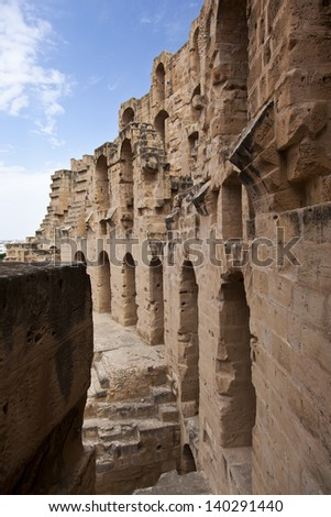 Ancient walls and arches in Tunisian Amphitheatre which name is El Djem, Tunisia. - stock photo