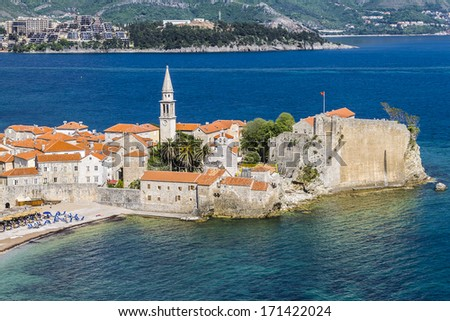 Ancient walls and tiled roof of old town Budva, Montenegro, Europe. Budva - one of the best preserved medieval cities in the Mediterranean.