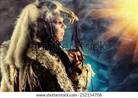 Ancient warrior Barbarian. Ethnic costume. Paganism, ritual. - stock photo