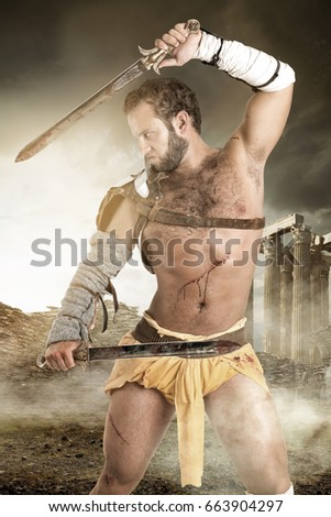 Ancient warrior or Gladiator posing outdoors with swords