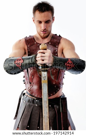 Ancient warrior with sword on white background - stock photo