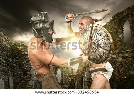 Ancient warriors in a battle in old ruins - stock photo