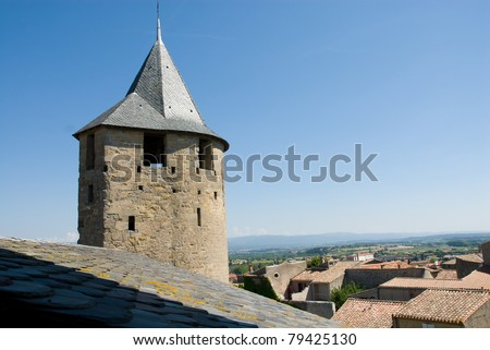 Ancient watchtower of Carcassonne chateau. Carcassonne is a ancient and fortified town in Aude department south France. It was added to the UNESCO list of World Heritage Sites in 1997. - stock photo